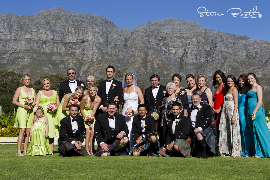 Family portrait at wedding with mountain