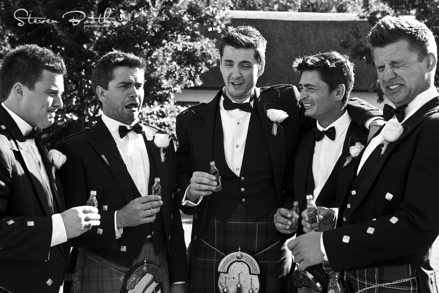 Groomsmen and whisky pulling faces