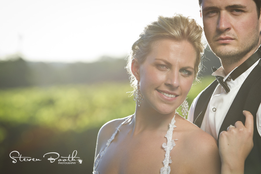 Bride smiling with sun from behind