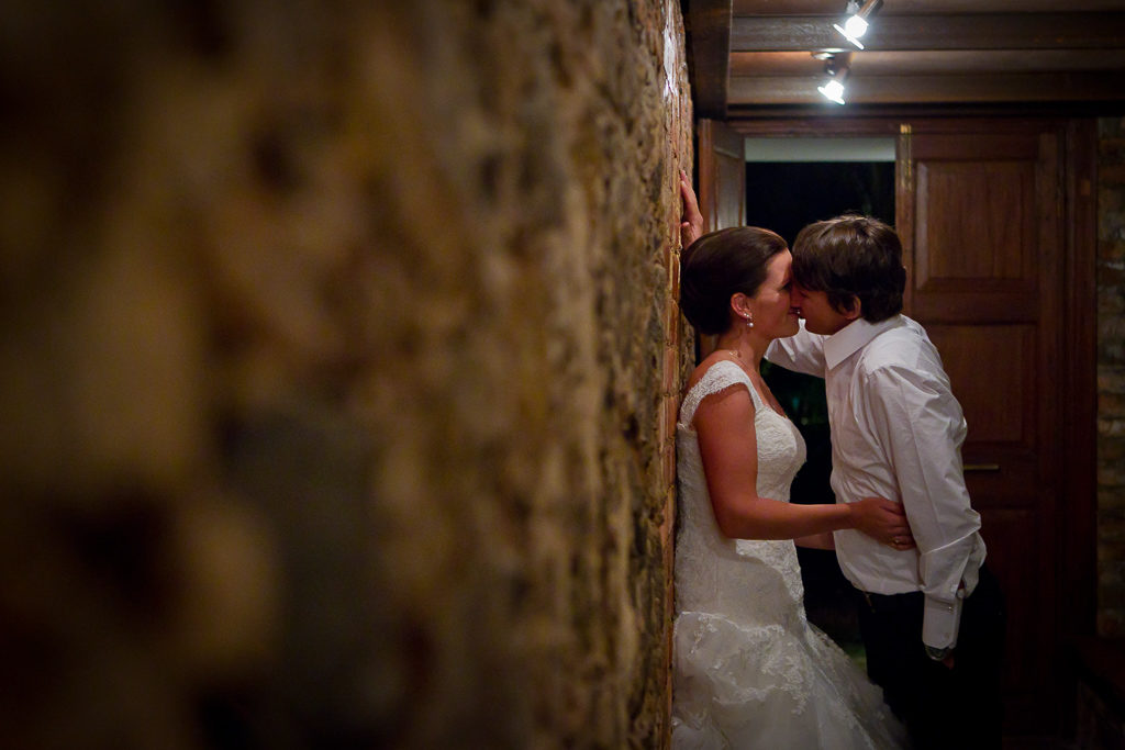 Couple kissing in passage