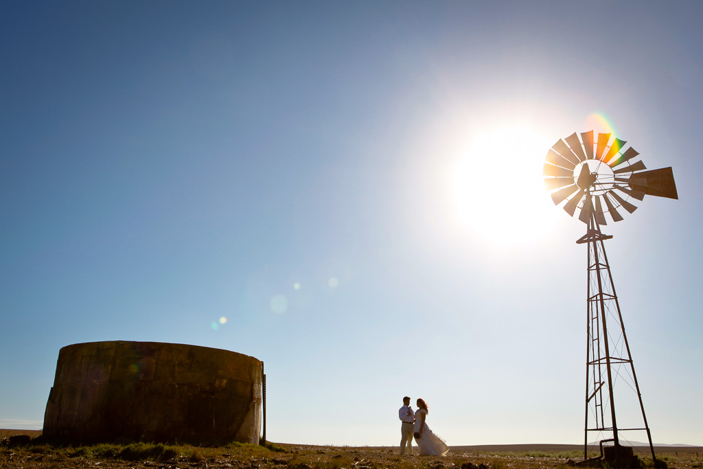 Couple with windmill and water tank
