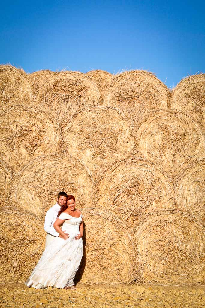 Couple and hay stack