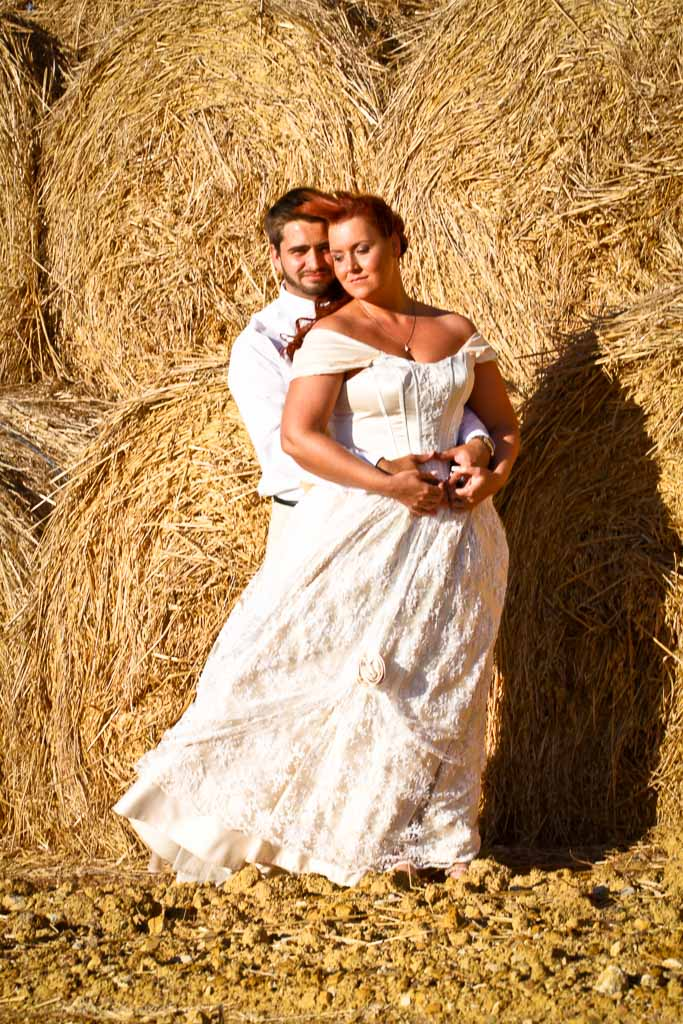 Couple and haystack close