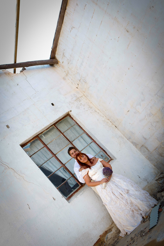 Couple embrace in abandoned building